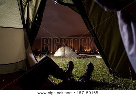 Tourist Lying In Tent With A View Of Camping