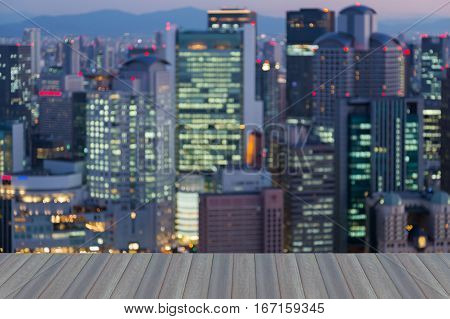 Opening wooden floor blurred lights Umeda city downtown abstract background