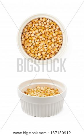 White ramekin dish filled with multiple corn kernels isolated over the white background, set of two different foreshortenings