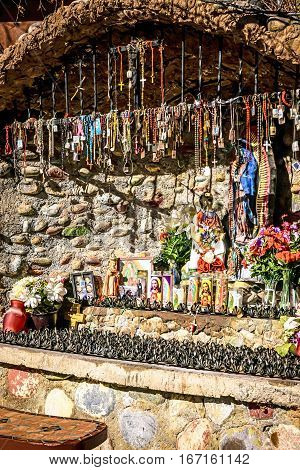Chimayo, New Mexico, USA - December 7: Religious tokens adorn the Shrine to the Virgin Mary at the Santuario de Chimayo in New Mexico