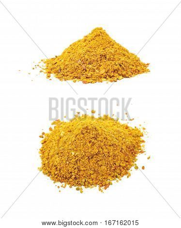 Pile of powdered yellow curry spice isolated over the white background, set of two different foreshortenings