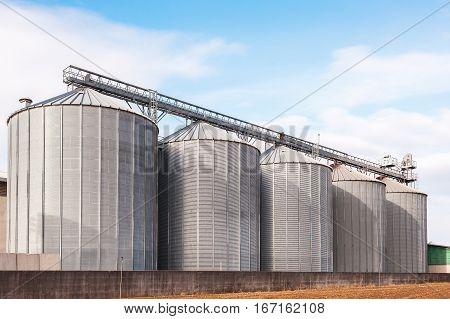 Agricultural Silos On Blue Sky.