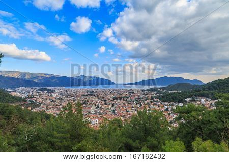 Marmaris cityscape during day time with clouds.