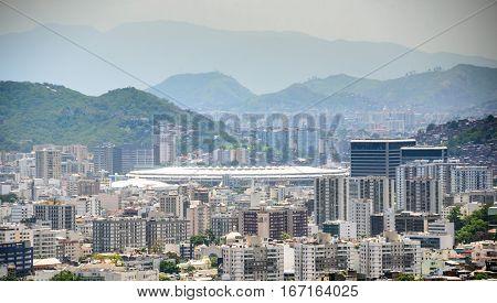 Aerial view from Santa Teresa hill to Sao Cristovao, Maracana and Tijuca neighborhoods, football Stadium and Tijuca Forest National Park of Northern Zone of Rio de Janeiro, Brazil