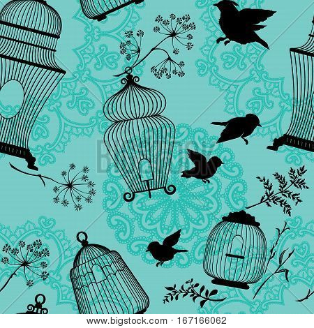 Seamless pattern with decorative bird cage black Silhouettes flying birds plants on blue background with mandala ornaments.