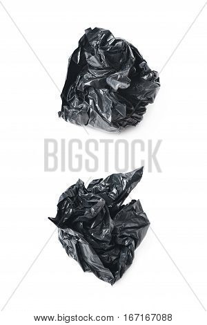 Black polyethylene trash bag crumpled in a ball isolated over the white background, set of two different foreshortenings