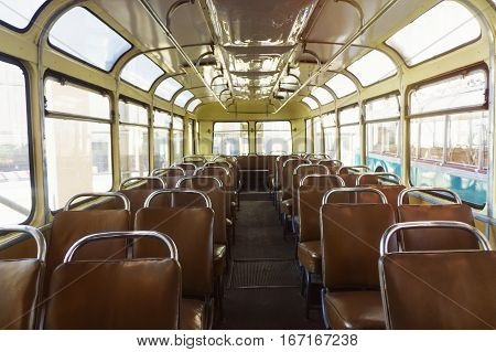 Old time bus cabin with old leather seats