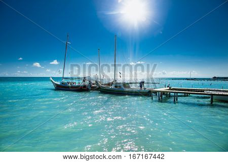 Panoramic view from sea at Caye Caulker dock.