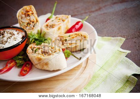 armenian shawarma on plate with chili peppers