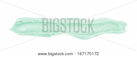 Smeared line of frosting cream isolated over the white background