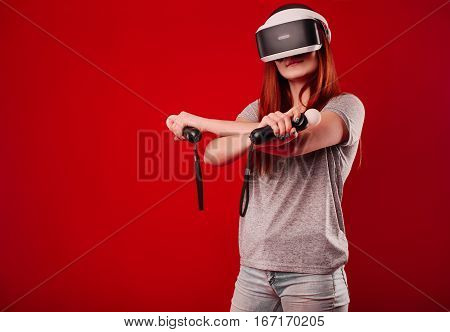 Woman using VR headset on red background