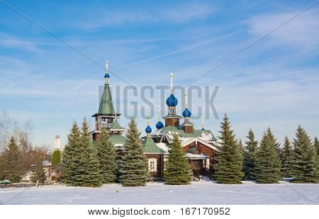 Winter landscape with a beautiful wooden church