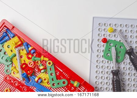 Toys background. Kids toy tool kit for education isolated on white background. Top view. Flat lay. Copy space for text