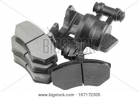 Brake pads and caliper car with shallow depth of field on a white background