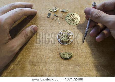 The procces of mechanical watch repair wih special tools