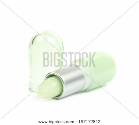 Vaseline lip balm stick pomade lying on its side, composition isolated over the white background