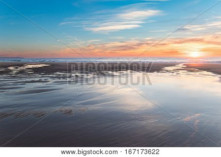Beautiful sunset at the beach in a warm winter evening.