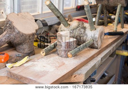 Making wooden reindeers from the logs in the shed selective focus