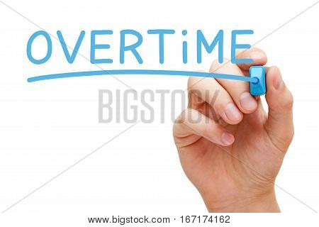 Hand writing Overtime with blue marker on transparent glass board.