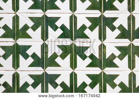 A pattern filling the frame made of green and white portugueses tiles