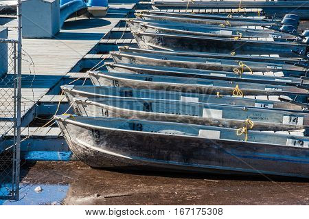 Bows of motorboats lined up along Lake Casitas dock.