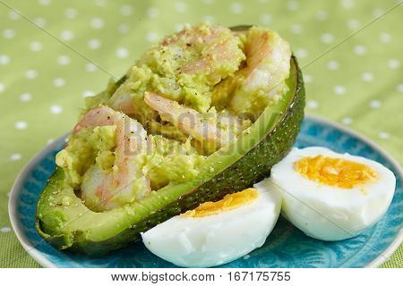 Stuffed avocado with garlic, eggs and shrimps