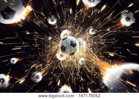 Explosion soccer balls with fire sparks in action black isolate