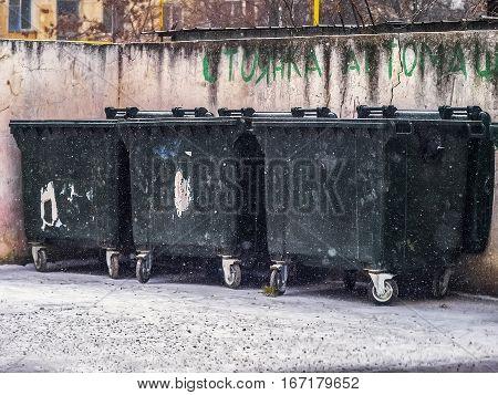 Three big dust trash bin in winter snow