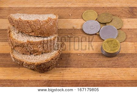 poverty and misery the composition on a wooden background black bread and a little money