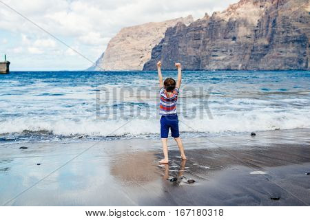 Happy Child Playing On Beach.