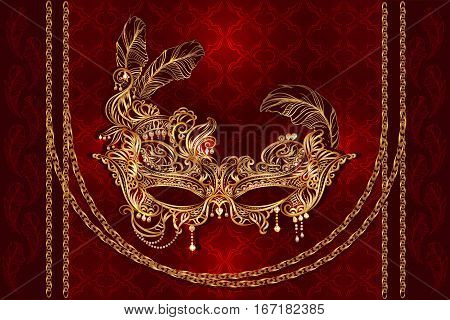 Luxury gold Venetian carnival mask with golden chains, feathers and pearls on a red velvet satiny