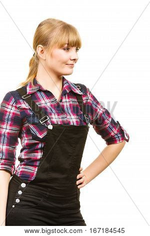 Gardening fahion concept. Smiling attractive woman in pink check shirt and dungarees. Isolated background