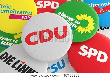 BERLIN GERMANY - JANUARY 29 2017: German Election Politics Badges: Pile of Buttons With The Logo of The Political Parties CDU CSU SPD FDP AfD The Left And The Greens 3d illustration