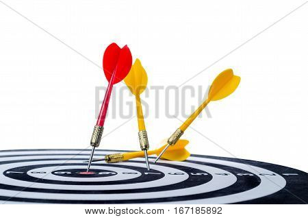 Close up shot red dart arrow on center of dartboard and yellow arrow not hit the target isolated on white backgkround with clipping path metaphor to target success winner and loser concept