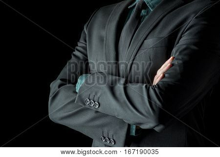 Businessman Standing With Folded Arms In A Classic Black Suit