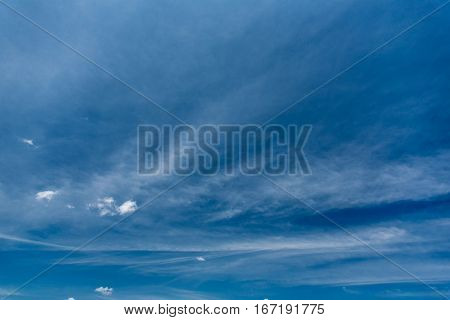 Beautiful vast sky deep blue color with white spindrift clouds at sunny summer day