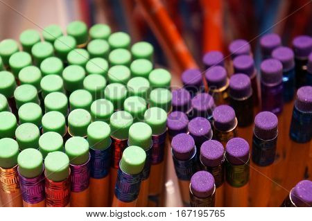 Collection of Pencils with Green and Purple Erasers, Close Up, with blurred background