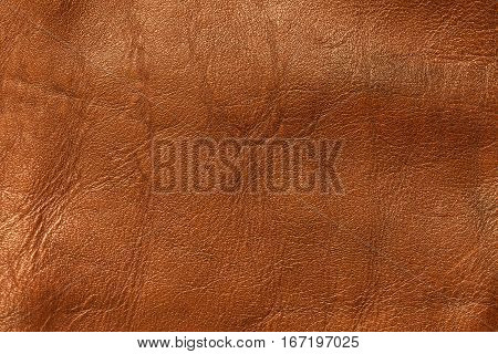 Orange with gold leather texture background closeup