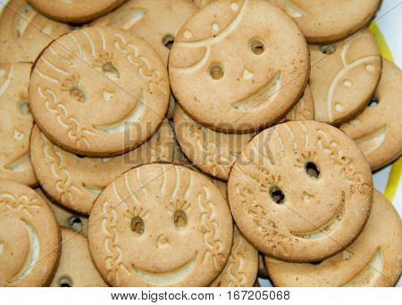 Background of the round tasty smiling cookies