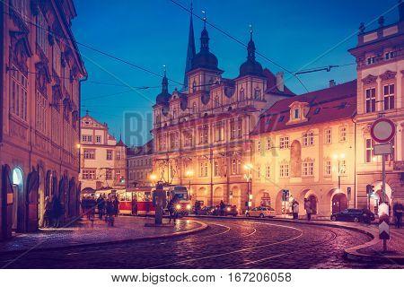 Prague square with old tram public transport dark evening street blue sky