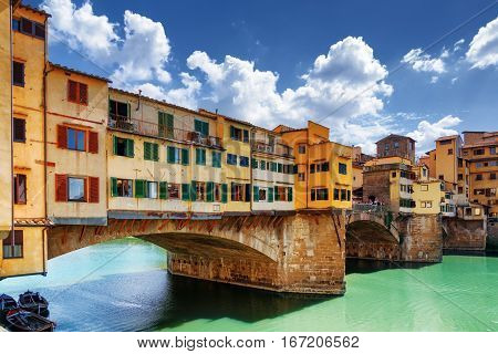 Side View Of Medieval Bridge Ponte Vecchio In Florence, Italy