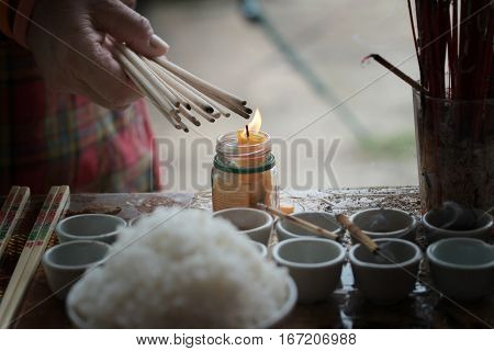Lighted Candle And Incense For Buddha.