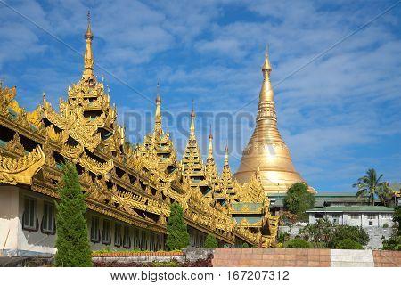 Gallery and the stupa of the old Shwedagon pagoda on a Sunny day. Yangon, Myanmar