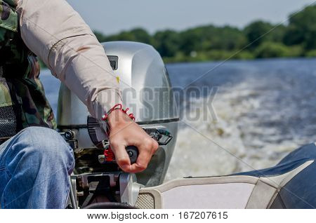 the person managing director of the boat during fishing on the river in the summer