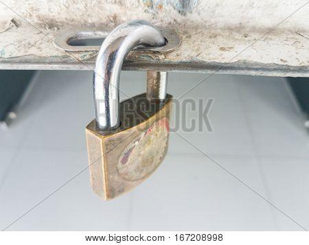 old master key padlocked at steel roller shutter doors