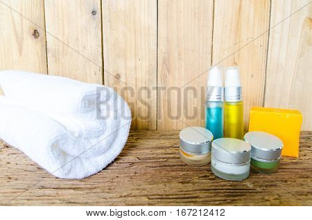 Spa Kit. Shampoo, Soap Bar And Liquid. Shower Gel. Towels. Wooden Table.