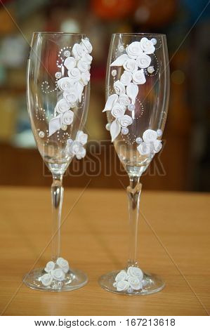 beautiful decor for celebration:wedding glasses of thin glass decorated with patterns of flowers from polymer clay