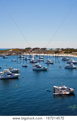 Boats moored in Geordie Bay on a hot summer day. Rottnest Island, Perth, Western Australia, Australia.