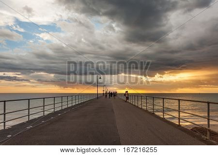 Glenelg Beach during a stormy sunset in Adelaide, South Australia, Australia