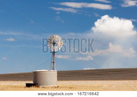 Windmill in the Australian outback - Red dirt - Flinders Range National Park, South Australia, Australia.
